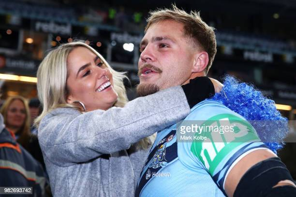 Jack de Belin of the Blues celebrates victory with his partner Alyce Taylor after game two of the State of Origin series between the New South Wales...
