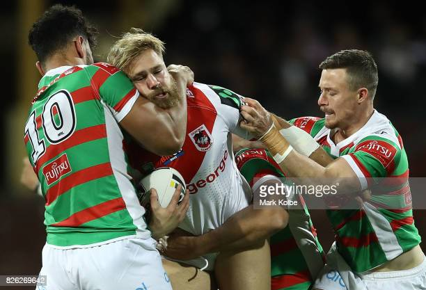 Jack de Belin of the Dragons is challenged by Zane Musgrove of the Rabbitohs during the round 22 NRL match between the St George Illawarra Dragons...