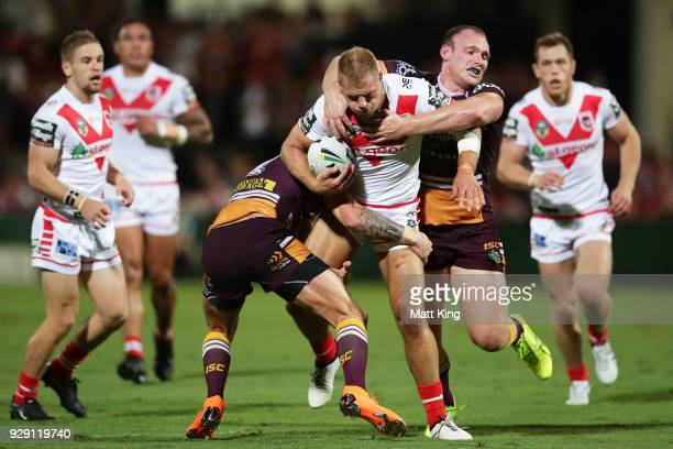 Jack De Belin of the Dragons is tackled by Matthew Lodge of the Broncos during the round one NRL match between the St George Illawarra Dragons and...