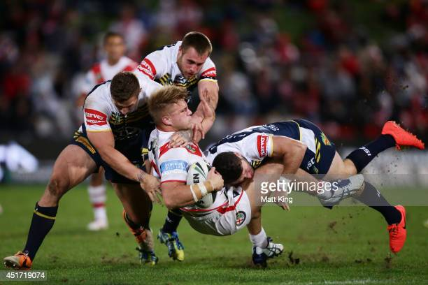Jack de Belin of the Dragons is tackled during the round 17 NRL match between the St George Illawarra Dragons and the North Queensland Cowboys at WIN...