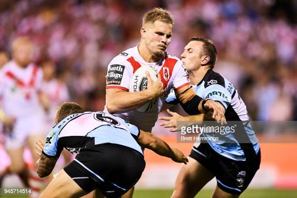 Jack De Belin of the Dragons is tackled during the round six NRL match between the St George Illawarra Dragons and the Cronulla Sharks at WIN Stadium...