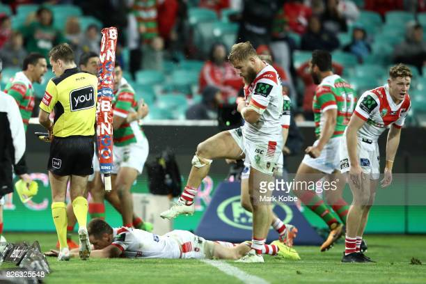 Jack de Belin of the Dragons kicks the corner post and hits the touch judge as he shows his frustration after a Rabbitohs try during the round 22 NRL...