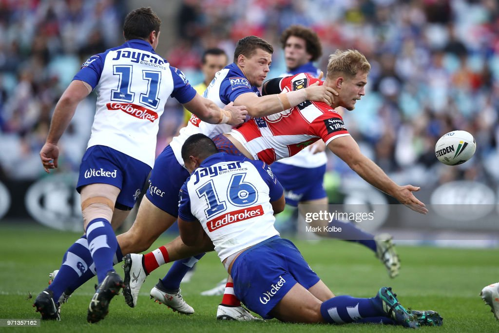Jack De Belin of the Dragons offloads as he is tackled during the round 14 NRL match between the Canterbury Bulldogs and the St George Illawarra Dragons at ANZ Stadium on June 11, 2018 in Sydney, Australia.