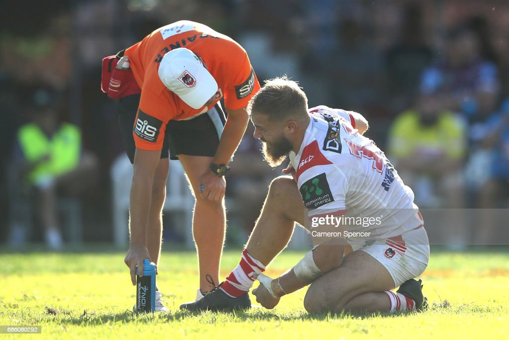 Jack De Belin of the Dragons receives attention during the round six NRL match between the Manly Sea Eagles and the St George Illawarra Dragons at Lottoland on April 8, 2017 in Sydney, Australia.