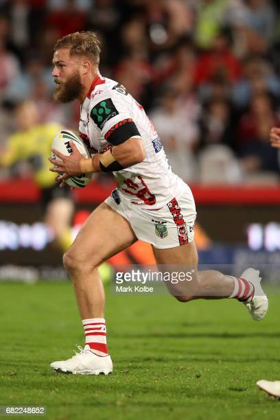 Jack de Belin of the Dragons runs the ball during the round 10 NRL match between the St George Illawarra Dragons and the Cronulla Sharks at UOW...