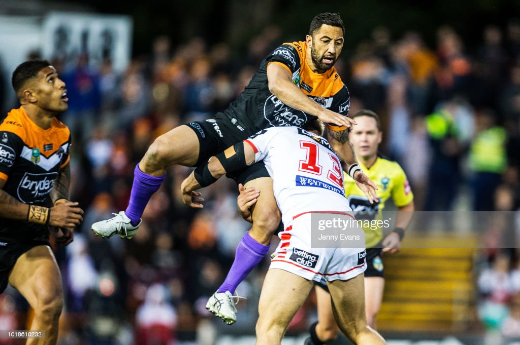 Jack De Belin of the Dragons tackles Benji Marshall of Tigers during the round 23 NRL match between the Wests Tigers and the St George Illawarra Dragons at Leichhardt Oval on August 18, 2018 in Sydney, Australia.