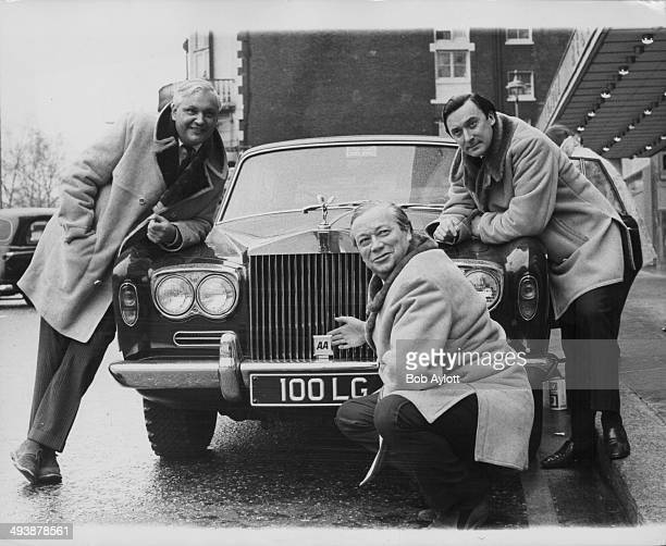 Jack de Manio, Tim Matthews and Iain Erskine, with the 'Today' program, posing next to the Rolls Royce they will soon be traveling to Russia in,...