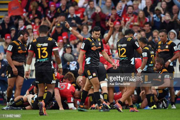 Jack Debreczeni of the Chiefs and his team mates look dejected after conceding a try during the round four Super Rugby match between the Crusaders...
