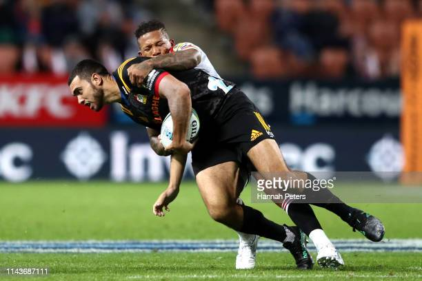 Jack Debreczeni of the Chiefs is brought down during the round 10 Super Rugby match between the Chiefs and the Lions at FMG Stadium on April 19 2019...