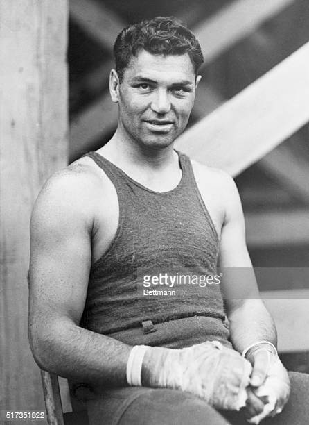 Jack Dempsey , American heavyweight fighter, seated with hands in boxing bandages. Undated photograph.