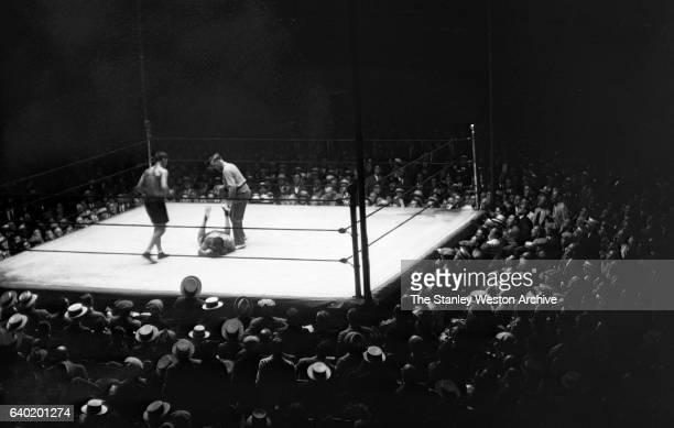 Jack Dempsey knocks out Jack Sharkey during the fight at Yankee Stadium Bronx New York July 21 1927 Jack Dempsey won by a KO 7