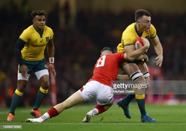 Jack Dempsey of Australia is tackled by Gareth Davies of Wales during the International Friendly match between Wales and Australia at Principality...
