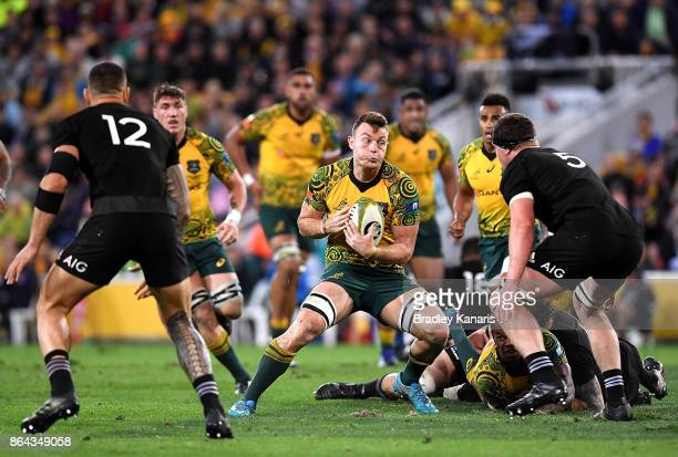 Jack Dempsey of the Wallabies takes on the defence during the Bledisloe Cup match between the Australian Wallabies and the New Zealand All Blacks at...