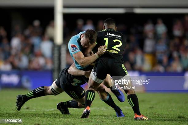 Jack Dempsey of the Waratahs is tackled during the round one Super Rugby match between the Waratahs and the Hurricanes at Brookvale Oval on February...