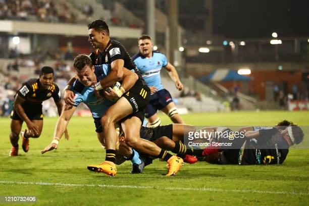 Jack Dempsey of the Waratahs scores a try during the round six Super Rugby match between the Waratahs and the Chiefs at WIN Stadium on March 06 2020...