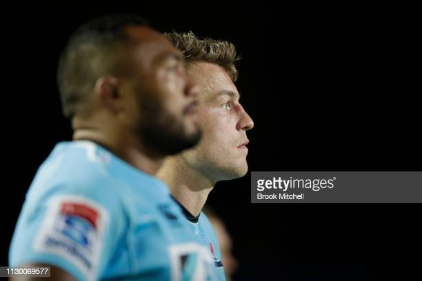 Jack Dempsy of the Waratahs watches on during the round one Super Rugby match between the Waratahs and the Hurricanes at Brookvale Oval on February...
