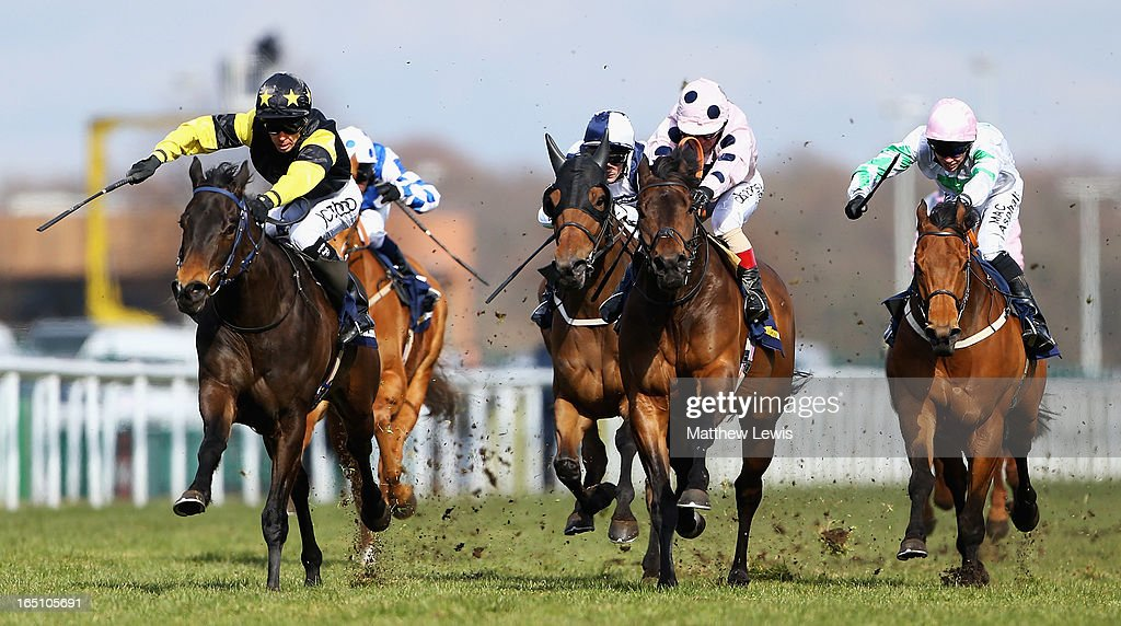 Jack Dexter (L) ridden by Graham Lee wins the William Hill New iPad App Cammidge Trophy (Class1) race ahead of Captain Ramius ridden by Franny Norton at Doncaster Racecourse on March 30, 2013 in Doncaster, England.