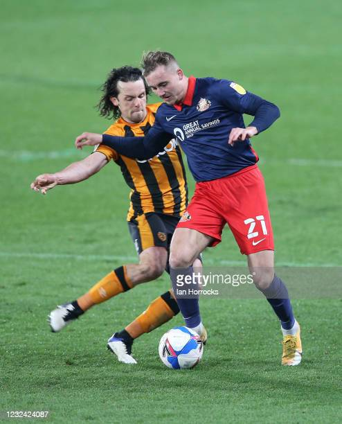 Jack Diamond of Sunderland is tackled by George Honeyman of Hull during the Sky Bet League One match between Hull City and Sunderland at the Kcom...