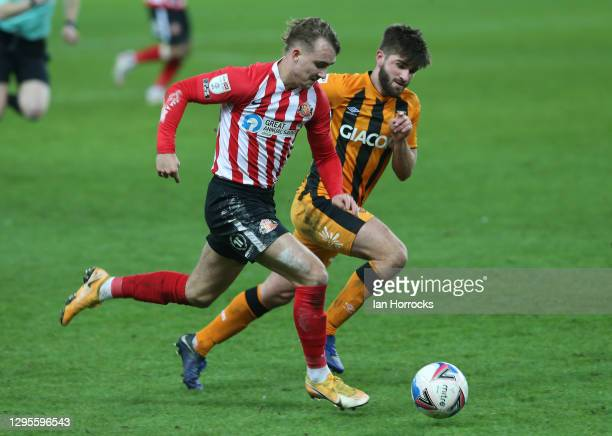 Jack Diamond of Sunderland takes on Brandon Fleming of Hull during the Sky Bet League One match between Sunderland and Hull City at Stadium of Light...