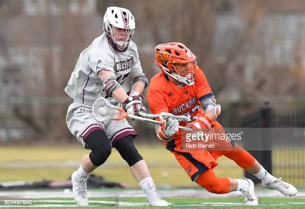 Jack Donaghue of the Colgate Raiders checks the stick of Will Sands of the Bucknell Bison during the first half at Andy Kerr Stadium on February 24...