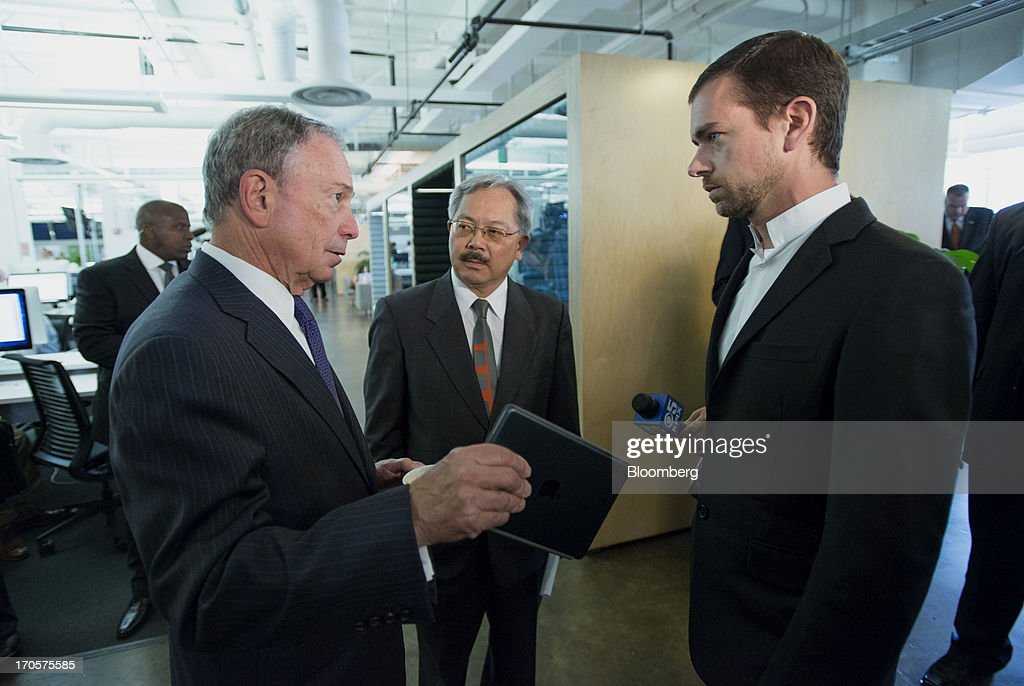 Jack Dorsey, chairman and co-founder of Twitter Inc., right, speaks with New York City Mayor Michael 'Mike' Bloomberg, left, as San Francisco Mayor Edward 'Ed' Lee listens after a press conference in San Francisco, California, U.S., on Friday, June 14, 2013. Dorsey, Mayor Bloomberg and Mayor Lee announced today that they will co-host the second annual Bloomberg Technology Summit to be held in New York on September 30. Photographer: David Paul Morris/Bloomberg via Getty Images