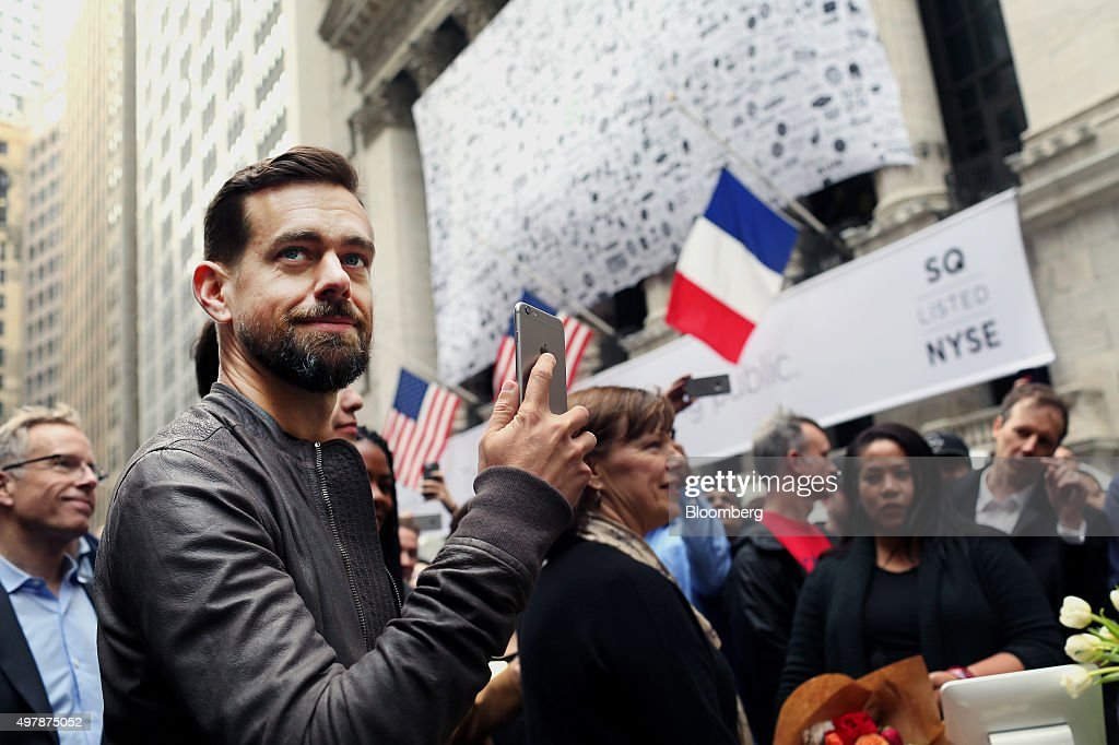 Jack Dorsey, chief executive officer of Square Inc., holds an Apple Inc. iPhone while standing outside of the New York Stock Exchange (NYSE) in New York, U.S., on Thursday, Nov. 19, 2015. Square Inc. jumped more than 60 percent after the mobile payments company priced its initial public offering low enough to entice skeptics as well as bulls who are confident in its growth prospects. Photographer: Yana Paskova/Bloomberg via Getty Images