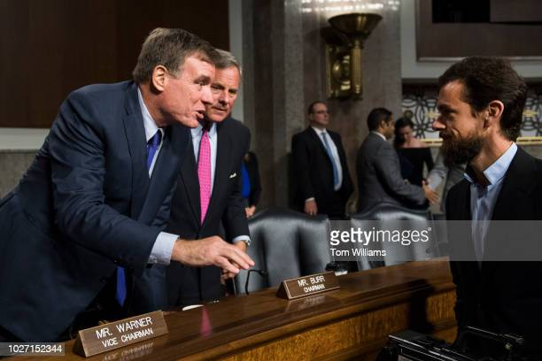 Jack Dorsey Twitter CEO greets Vice Chairman Sen Mark Warner DVa left and Chairman Richard Burr RNC after a Senate Intelligence Committee hearing in...