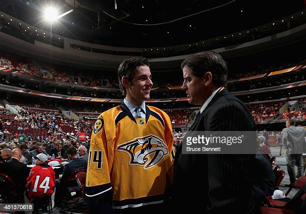 Jack Dougherty meets Head Coach Peter Laviolette after being drafted by the Nashville Predators on Day Two of the 2014 NHL Draft at the Wells Fargo...