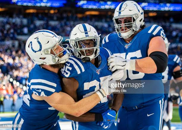 Jack Doyle Marlon Mack and Quenton Nelson of the Indianapolis Colts celebrate after Mack ran for a touchdown in the third quarter of the game against...