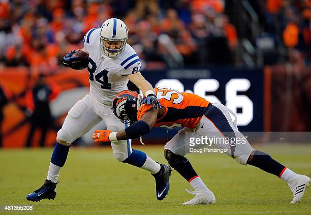 Jack Doyle of the Indianapolis Colts carries the ball as Von Miller of the Denver Broncos tries to make the tackle during a 2015 AFC Divisional...