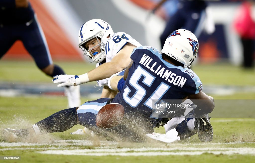 Jack Doyle #84 of the Indianapolis Colts fumbles the ball as he is tackled by Avery Williamson #54 of the Tennessee Titans during the game at Nissan Stadium on October 16, 2017 in Nashville, Tennessee.