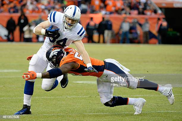 Jack Doyle of the Indianapolis Colts is tackled by Von Miller of the Denver Broncos during a 2015 AFC Divisional Playoff game at Sports Authority...