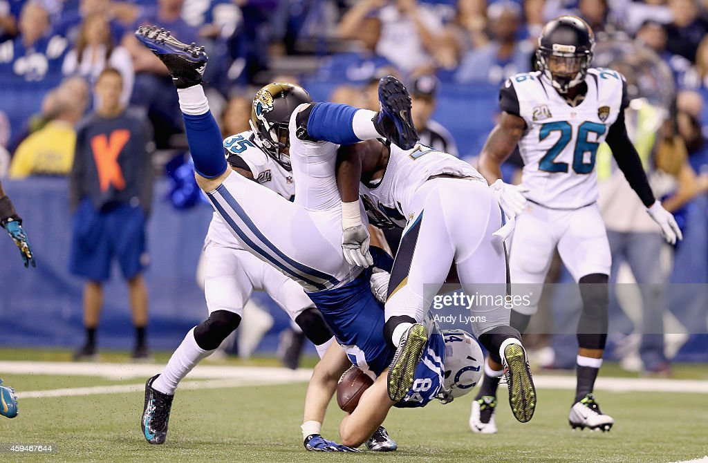 Jack Doyle #84 of the Indianapolis Colts is upended short of the goal line during the game against the Jacksonville Jaguars at Lucas Oil Stadium on November 23, 2014 in Indianapolis, Indiana.