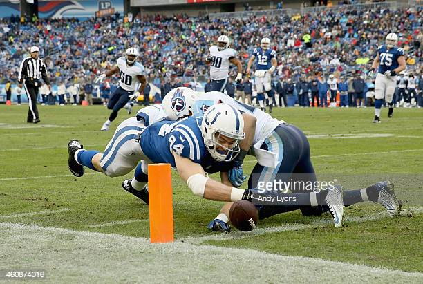 Jack Doyle of the Indianapolis Colts reaches to score a touchdown during the game against the Tennessee Titans at LP Field on December 28 2014 in...