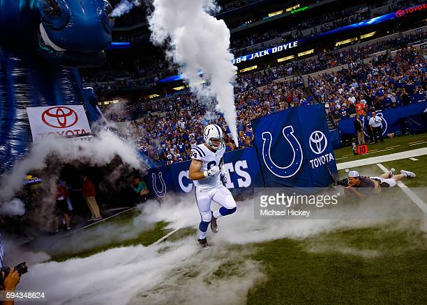 Jack Doyle of the Indianapolis Colts takes the field during player intros before the game against the Baltimore Ravens at Lucas Oil Stadium on August...