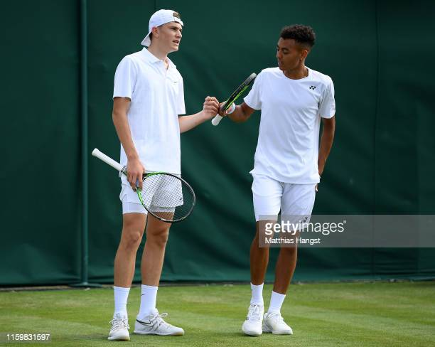 Jack Draper of Great Britain and Paul Jubb of Great Britain speak in their the Men's Doubles first round match against Juan Sebastian Cabal of...