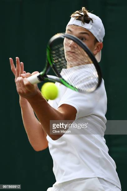 Jack Draper of Great Britain in action during his Boy's Singles semifinal match against Nicolas Mejia of Colombia on day eleven of the Wimbledon Lawn...