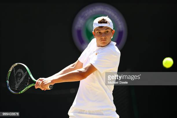 Jack Draper of Great Britain returns against Chun Hsin Tseng of Taiwan during the Boys' Singles final on day thirteen of the Wimbledon Lawn Tennis...