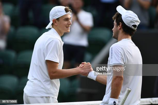 Jack Draper of Great Britain shakes hands with Nicolas Mejia of Colombia after their Boy's Singles semifinal match on day eleven of the Wimbledon...