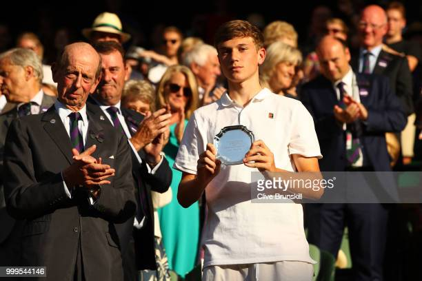 Jack Draper of Great runnerup in the Boys' Singles final poses with his trophy at Centre Court on day thirteen of the Wimbledon Lawn Tennis...