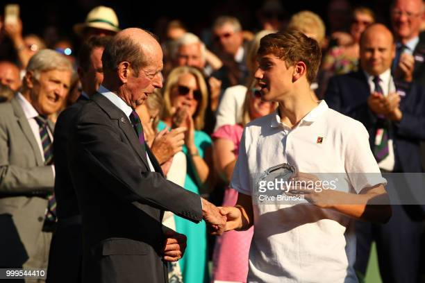 Jack Draper of Great runnerup in the Boys' Singles final shakes hands with Prince Edward Duke of Kent at Centre Court on day thirteen of the...