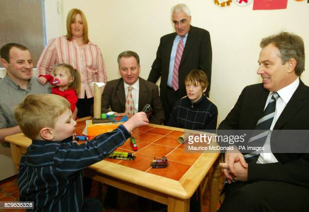 Jack Duff shows British Prime Minister Tony Blair his train as father Andrew Duff 41 sister Rachel Mother Caroline Duff Scotland's First Minister...