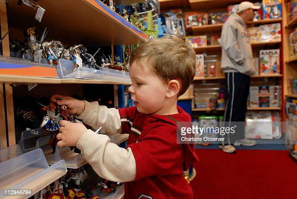 Jack Duncan left plays with mini figurines made in France while visiting Toys Co November 26 in Charlotte North Carolina This holiday season the...