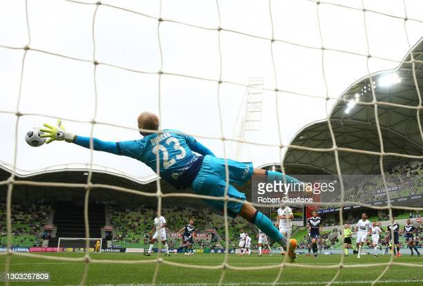 Jack Duncan of the Jets makes a save to stop a shot from Callum McManaman of the Victory during the A-League match between the Melbourne Victory and...