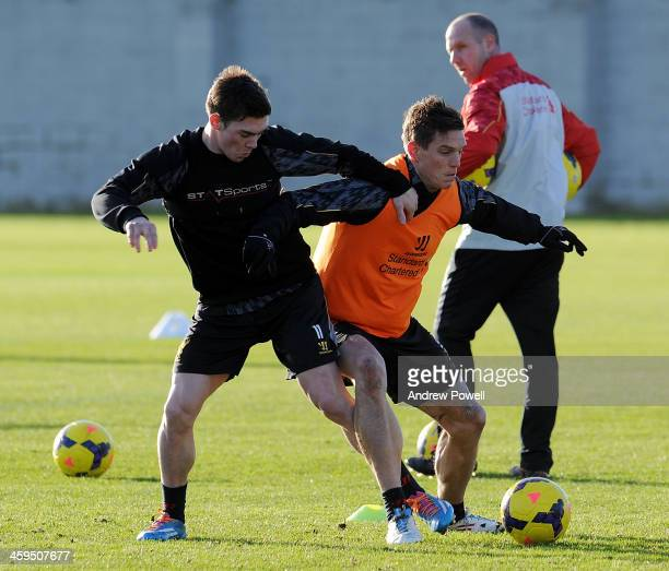 Jack Dunn and Daniel Agger of Liverpool in action during a training session at Melwood Training Ground on December 27 2013 in Liverpool England