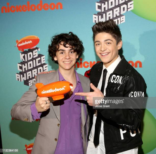 Jack Dylan Grazer and Asher Angel attend the Pinkberry green room backstage at Nickelodeon's 2019 Kids' Choice on March 23, 2019 in Los Angeles,...