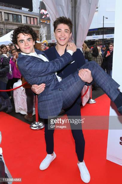 Jack Dylan Grazer and Asher Angel attend the unveiling of the Shazam World Exclusive Fan Experience on March 14 2019 in Toronto Canada