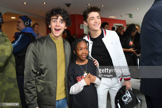 Jack Dylan Grazer and Asher Angel poses with Big Brothers And Sisters at Canada's CN Tower on March 14, 2019 in Toronto, Canada.