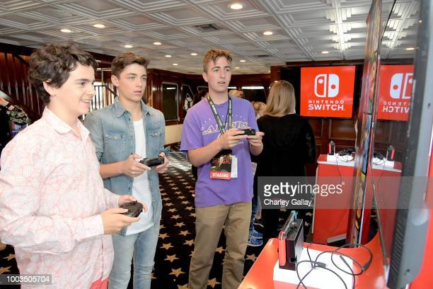 Jack Dylan Grazer and Asher Angel test their skills on Super Smash Bros Ultimate for Nintendo Switch at the Variety Studio at ComicCon 2018 on July...
