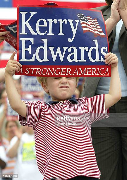 Jack Edwards holds a sign during a rally for democratic presidential candidate US Senator John Kerry and his father vice presidential candidate US...